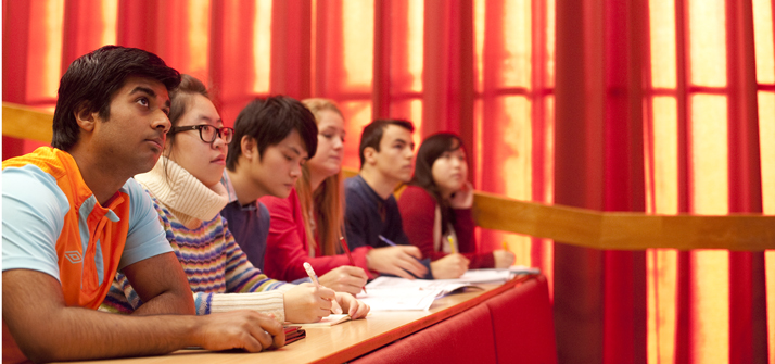 students-in-lecture-red-curtains