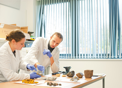 Archaeology students at Nottingham working in the dirty materials laboratory