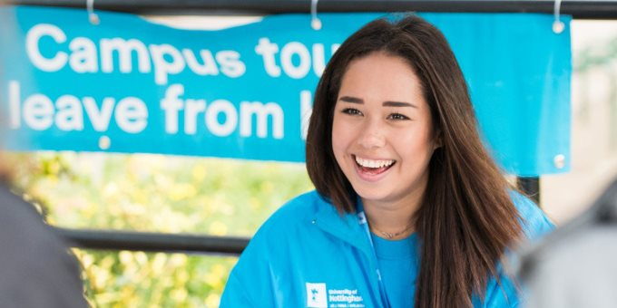 Female open day helper smiling in a blue hoodie