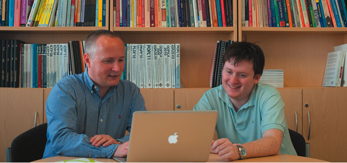 Graham Hutton and Laurence Day discussing research