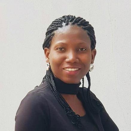 Busola Adebusoye smiling at the camera
