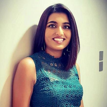 Kavita Raniga smiling at the camera