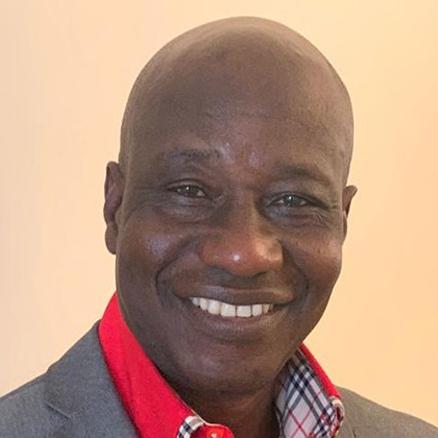 A headshot photo of Maxwell Ayamba, PhD Black Studies student