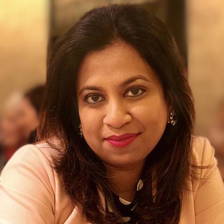 Nadia Islam smiling at the camera