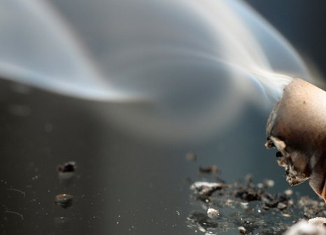 Cigarette butt with smoke