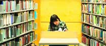 Female undergraduate student studying in the Learning Resource Centre, Jubilee Campus