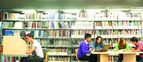 Undergraduate and postgraduate students studying in the Learning Resource Centre, Jubilee Campus
