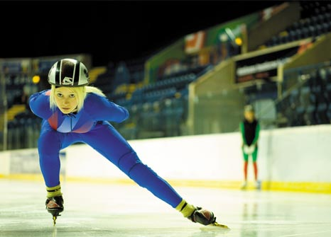 Female postgraduate speed skater and sports bursar training at the National Ice Centre, Nottingham
