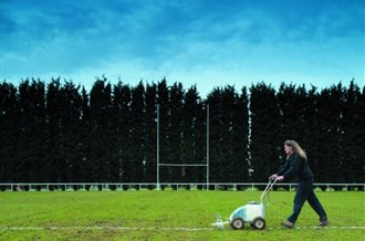 grounds person lining a rugby pitch with a fleet combi marking machine