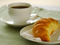 image of cup of coffee and a croissant