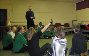 Andy Fisher with a group of pupils at a Philosophy in Schools session