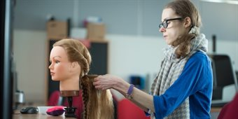 classics-female-student-hair-braiding