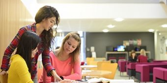 female-students-in-atrium-working