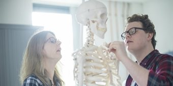student-inspecting-a-skeleton