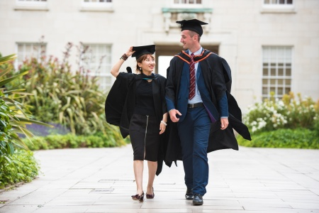 Female and male Graduates in cap and gown