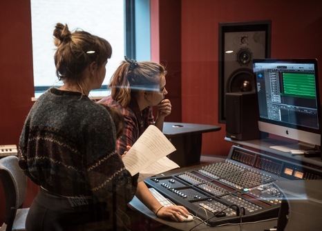 female-students-computer-recording-studio