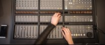 hands-working-on-recording-studio