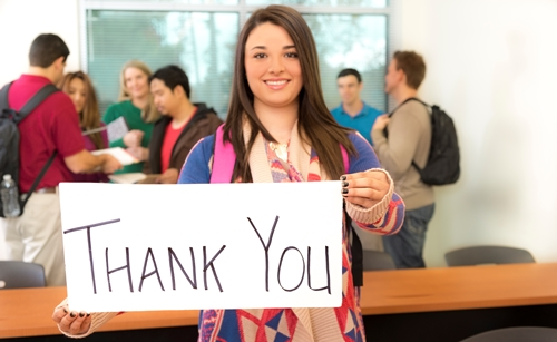 Girl with a thank you sign