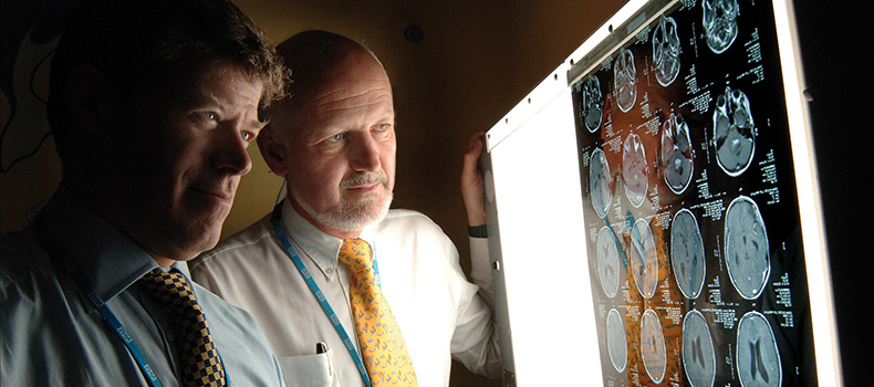 CBTRC co-directors, Professor David Walker and Professor Richard Grundy examining a brain scan