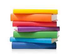 Stack of books in different colours to make a rainbow