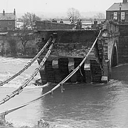 Photograph showing Cavendish Bridge destroyed after flooding in 1947 in Shardlow, Derbyshire