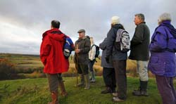 Stuart Rose leading a group of visitors on a guided walk of Laxton