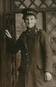 Sepia photo of a female stationmaster, in her uniform