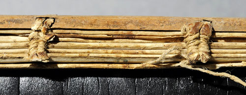 Medieval sewing evidence in the spine of WLC/LM/11