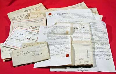Photograph of a bundle of title deeds, 1742-1817 (Ne 6 D 2/31/1-21)