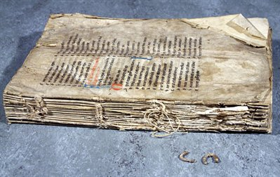 WLC/LM/3, before conservation, unbound, showing damage to stitching at the spine