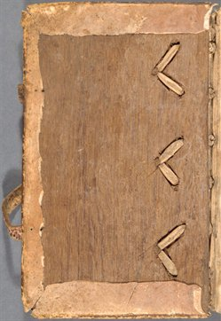 Inside view of front cover of WLC/LM/9, showing cords threaded inside wooden board
