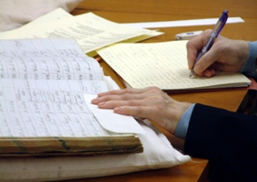 Photograph showing a reader using archival material