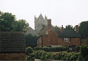 Photograph of a house at Laxton, with the east end of the church in the background, 2008.