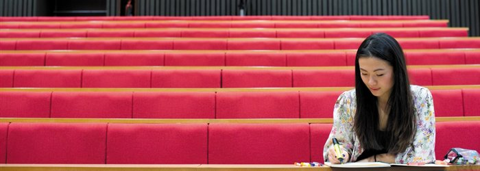 Student sitting in a lecture theatre