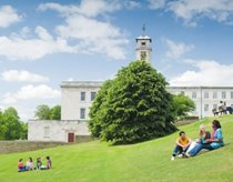 Students sat on the grass by the Trent Building