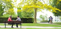 Students sat on a bench as University Park