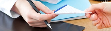 GP giving a prescription to a patient