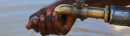 African child using a water standpipe