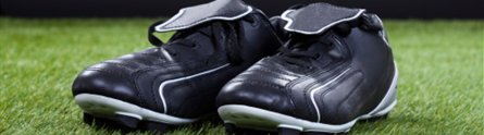 Football boots on a pitch