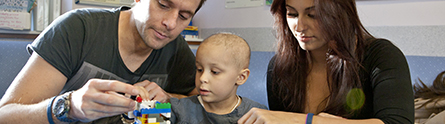A young patient and parents at the Children's Brain Tumour Research Centre