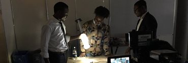 Members of Liter of Light Nigeria project team working on the solar lamp