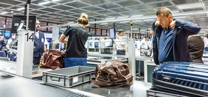 Airport security plastic trays harbour highest levels of viruses, study finds