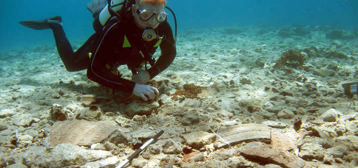 Diver over a spread of sherds from a Bronze Age storage jar