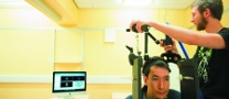 Male postgraduate student stimulating a patient using TMS (Transcranial Magnetic Stimulation)