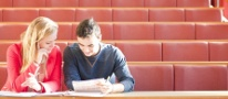 Female and male postgraduate students studying