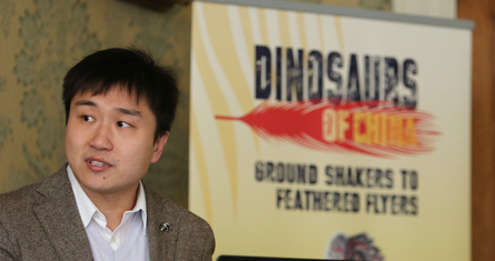 Dr Wang Qi at the Dinosaurs of China exhibit