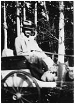 Lawrence in a carriage in Paris