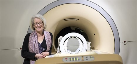 Professor Penny Gowland standing in front of the MRI scanner - MRI