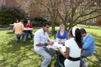 Students studying outside around a table