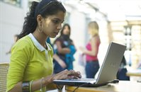 Female student using laptop